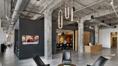 Nearly a century of layered paint creates texture on walls throughout these offices for an advertising agency in North Carolina, created by TPG Architecture
