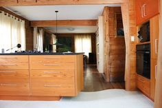 """Name: Woodworker and craftsman Mark Maček, his lovely wife Pamela Peltz and three adorable cats Location: Gullet Gardens — East Austin, Texas Size: 1500 square feet Years lived in: 7 1/2 years — owned Mark Maček's first impression upon seeing a tiny photo of the exterior of this house in the MLS listing was that this looked like a """"house."""" An archetypal structure, with a gable roof and a homey feeling. Like what you think of when you think of """"home."""" It's good he had that initial thought…"""