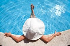 Picture of Unrecognizable woman in big hat relaxing on the swimming pool stock photo, images and stock photography. Pool Maintenance Cost, Swimming Pool Maintenance, Peeing In The Pool, Vida Natural, Girlfriends Getaway, Pool Service, Relax, Pool Builders, Pool Cleaning