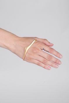 Bijules | Gold Handlet. Never seen this before... Not sure if I'd wear it (wondering how secure it is) but I like the concept.