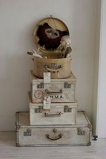 Luv the suitcases to use as storage & decor & maybe find an old hat box to top it off.