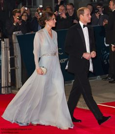 Duchess Kate: It's Jenny Packham & Dazzling Earrings for Kate's Date with 007. James Bond Spectre premiere. Kate chose a flowing duck egg blue bespoke gown by Jenny Packham for the premiere. It features sheer sleeves, a glittering belt and sheer overlay.