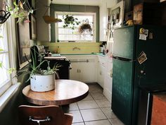 Eclectic green and yellow kitchen (the fridge is painted with chalkboard paint!) – from the LA home of Jessica Lundby