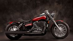 Honda Shadow 750 Aero Bobber Motorcycle First off we have the Honda Shadow 750 Aero Red and Black Bobber Motorcycle. The classic lines were kept and were enhanced with the cut motorcycle fender. The entire motorcycle is wrapped up with a great paint job. Honda Bobber, Honda 750, Harley Bobber, Honda Bikes, Bobber Motorcycle, Bobber Chopper, Cruiser Motorcycle, Honda Motorcycles, Moto Shadow