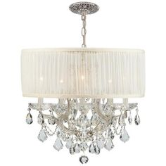 Brentwood collection chrome 6-light crystal chandelier. A fabric shade wraps around this crisp, clean, beautiful, chandelier design.