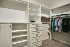 Well-organized walk-in closet // Love the mix of open shelling, racks, drawers, and show storage