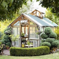 While most garden sheds look like miniatures houses, this shed forges a different design path with cool shed ideas of its own. Salvaged materials form the greenhouse's structure and set a casual tone. The surrounding formal topiaries and hedges, inspired Diy Greenhouse Plans, Best Greenhouse, Greenhouse Wedding, Backyard Greenhouse, Old Window Greenhouse, Greenhouse Panels, Homemade Greenhouse, Portable Greenhouse, Backyard Sheds