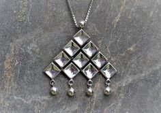 "Uni David Andersen (NO), mid-century modernist geometric kinetic pendant with concave squares in a ""waffle-like"" form and silver spheres, 1960s. #norway #etsy 