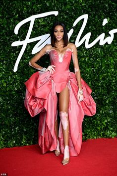 Winnie Harlow, stood out from the crowd as she hit the red carpet in a salmon pink puff-ball dress for the British Fashion Awards as the Royal Albert Hall on Monday. Winnie Harlow, Olivia Culpo, Lily James, Donatella Versace, Naomi Watts, Julia Roberts, Emilia Clarke, Irina Shayk, Kylie Minogue