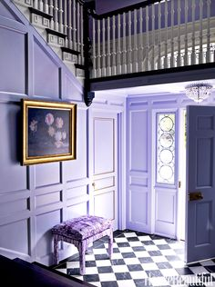 By painting both the walls and trim in Benjamin Moore's Lavender Mist, Mary McGee bathed the entrance hall in the favorite color of her client, Mari Sugahara Lathrop. Bench from Tallulah.
