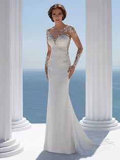 This comfortable crepe fabric hugs and flares out at the bottom. With a gorgeous illusion back and sleeves they're detailed with gorgeous beaded lace motifs. Plain Wedding Dress, Top Wedding Dresses, Wedding Dress Sleeves, Perfect Wedding Dress, Designer Wedding Dresses, Bridal Dresses, Wedding Gowns, Bridesmaid Dresses, Fit And Flare