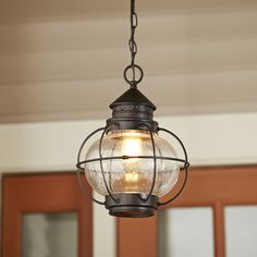 Hastings Outdoor Hanging Lantern | The squat, round style of this pendant is reminiscent of vintage lanterns with just a touch of nautical flair.