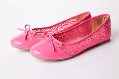 American Eagle bright pink flats with bow, $29.99 at Payless Shoes.
