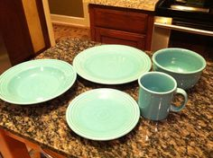 Tina's First place setting of FiestaWare, she is purchasing this year ~. Each month, another hue:). This is January~ #1 place setting ~  Aqua ~ Green !!
