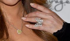 Singer/songwriter Mariah Carey, jewelry detail, arrives at 1 OAK Nightclub at the Mirage Hotel & Casino on July 26, 2015 in Las Vegas, Nevada.