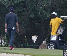 Michael Jordan in a big yellow shirt, leaning on a golf cart, and Tom Brady carrying a golf club with a glove hanging out of his back pocket.