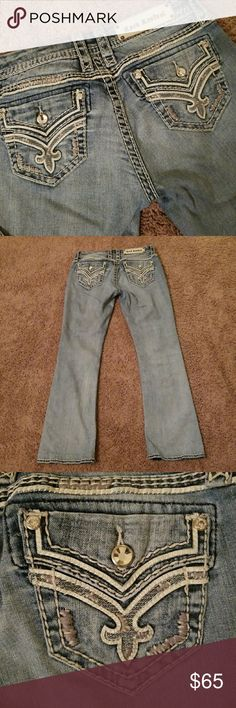 🌼Rock Revival jeans Boot cut lightly distressed Rock Revival jeans size 28. These are trimmed in off white leather with all stubs none missing. These are one of the most comfortable pair I own! The length is 28 inches. Rock Revival Jeans Boot Cut