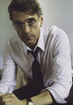 Tired men look best in half glasses, white shirts with the sleeves rolled up, tie at half mast and a hint of stubble. Just sayin...in case you needed to know that........  Jeremy Irons for Donna Karan ad campaign for Spring 2001.