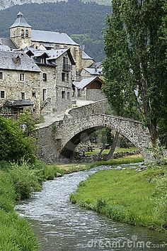Photo about A stone bridge spans a stream as it flows past the ancient city ofTorla in northern Spain. Image of bridge, town, architecture - 22976 Places To Travel, Places To See, Places Around The World, Around The Worlds, Medieval Village, Ancient City, Destination Voyage, Aragon, Spain And Portugal