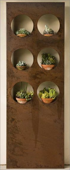 Our innovative and very contemporary Port Hole Wall provides a unique display area for feature plants as well as adding depth and geometry to a modern scheme. Ideal for courtyards, where it could be back-lit, or a balcony wall where space is limited. Work with the raw beauty of it's rusted metal finish by adding other pieces from our extensive range.Features    Port Hole Wall crafted from metal in a rust finish.    Pots not included.    Contemporary & Outdoor Living Styles.
