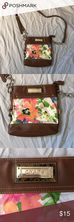 Chaos Floral Cross body Purse Good condition, minor marks on the inside of one of the pockets, but can't be seen when worn at all. Very spacious little bag, has one big zipper Pocket and two other ones. Bought for $50 originally. Chaps Bags Crossbody Bags