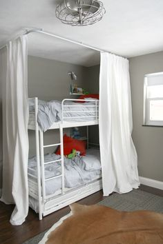 hospital track curtains around bunkbed = fort/playhouse/awesomeness    could go really girly with this, although this pic is def industrial  hideaway4
