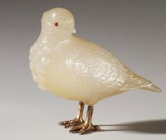 Both King Edward VII and the Prince of Wales (later King George V) kept homing pigeons at Sandringham next to Queen Alexandra's dove-house. According to contemporary accounts, most of the pigeons were of famous Belgian breeds. This one is of carved chalcedony with ruby eyes. Text adapted from Fabergé's Animals: A Royal Farm in Miniature Provenance Commissioned by King Edward VII, 1907