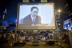 Week of Oct 18-24, 2014 Pro-democracy protesters watch Hong Kong Justice Secretary Rimsky Yuen Kwok-keung projected onto a large screen during talks Tuesday between pro-democracy student leaders and the government outside the Central Government Offices. Brent Lewin/Bloomberg News