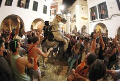 A rider rears up on his horse while surrounded by a cheering crowd during the traditional Fiesta of San Joan (Saint John) in downtown Ciutadella, on the Spanish Balearic Island of Menorca on June 24. The riders of the horses are the representatives of ancient Ciutadella society: nobility, clergy, craftsmen & farmers