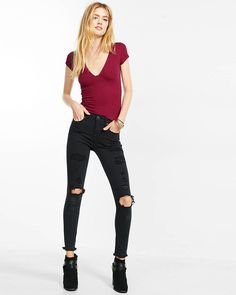 The saturated black surface and frayed hem of these distressed, leggings make them a fresh take on a wardrobe staple. This body-loving pair is super chic with a don't-care attitude.