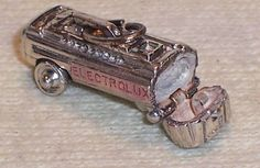 Vintage Sterling Silver Enamel Electrolux Vacuum Cleaner Charm Moves Unique | eBay  This is a Vintage Sterling Silver Enamel ELECTROLUX VACUUM CLEANER Charm that is a mechanical. The wheels move as well as opens.  This is in great condition and is double sided (the same on both sides).  I have never seen this particular charm before. It measures 7/8 inches long and 3/8 inches wide.