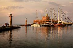 rhodes old port at sunset