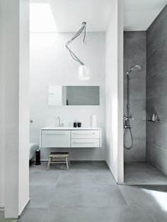 I like how this shower is tucked in here...(Vipp)