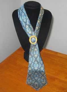 Blue necktie for women with vintage yellow buckle. via Etsy.