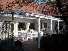 An aluminium veranda makes a versatile and stylish addition to any home