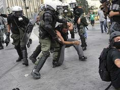 By Louisa Gouliamaki, AFP/Getty Images Tags: Greece, Athens 10/5/2011 Police detain a demonstrator during a protest rally marking the 24-hours general strike today in Athens, Greece.