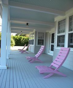 Who'd want to go inside with this lovely front porch and pink adirondack chairs