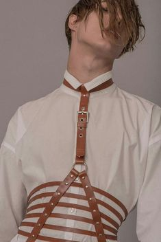 BITCH THIS IS THE HARNESS BELT CORSET THING THAT TAEHYUNG WORE IN FAKE LOVE