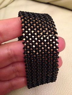 This is done with two-hole beads, also. Very nice!  Look at it enlarged to see it in a better perspective.  It looks like simple right angle weave, but when done with two-hole beads could be more complicated.