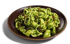 This twist on classic pesto swaps arugula for basil, making a peppery sauce that goes nicely with toasted pine nuts and sun-dried tomatoes. For something extra...