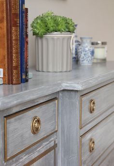 Dresser makeover with Chalky White washed over Anthracite Chalk finish Paint by Rustoleum.  Trim in gold rub n buff