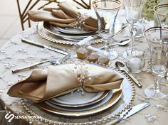 A decorative napkin ring that ties into the detailed table linen for an elegant vintage-themed wedding. Photo Courtesy of Michael Fragale. For more wedding photos, please visit http://www.sensationalweddings.com/