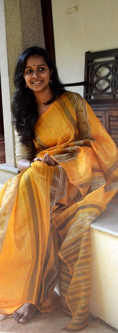 Nadai- A collection of hand woven Sarees.. Lovely model!