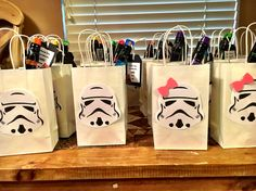 Storm Trooper party bags...print and cut made pink bows for the girls