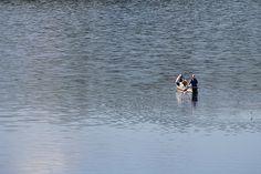 Pescadores en lago Calima. Colombia