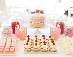 Pink food. Coconut ice, cupcakes, pink drink, candy and cake