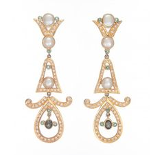 Stylish and elegant Chandeliar earrings made in Sterling Silver by using semi precious stones-Amethyst,Cubic Zirconia and Peridot in Purple,Parrot Green and White colour is an eye-turner and give that contemporary look and can be worn with western or Indo Western outfits. Suitable for all Occasions.