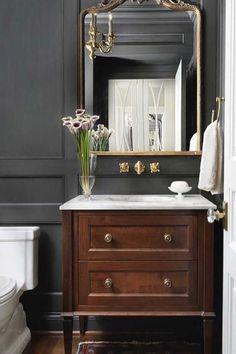 Traditional bathroom 395261304793179015 - Powder room This chic and classic powder room features a custom furniture-looking vanity with white marble countertop and floor-to-ceiling paneling, painted in a custom charcoal stain color Source by Bad Inspiration, Bathroom Inspiration, Bathroom Ideas, Bathroom Designs, Bathroom Remodeling, Bathroom Interior Design, Decor Interior Design, Design Bedroom, Lavabo Vintage