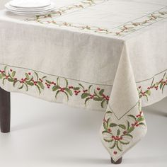 Set an elegant holiday table with the Holly Tablecloth by Saro Lifestyle. Featuring a festive holly design embroidered on a natural linen blend fabric, this vibrant oblong design helps you celebrate the holidays in style. Tablecloth Sizes, Linen Tablecloth, Table Linens, Christmas Table Linen, Christmas Sheets, Holiday Tablecloths, Deco Table, Holiday Tables, Natural Linen