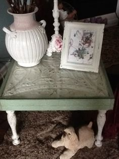 Old tin ceiling tile table, with old beadboard and banister rails. So original!